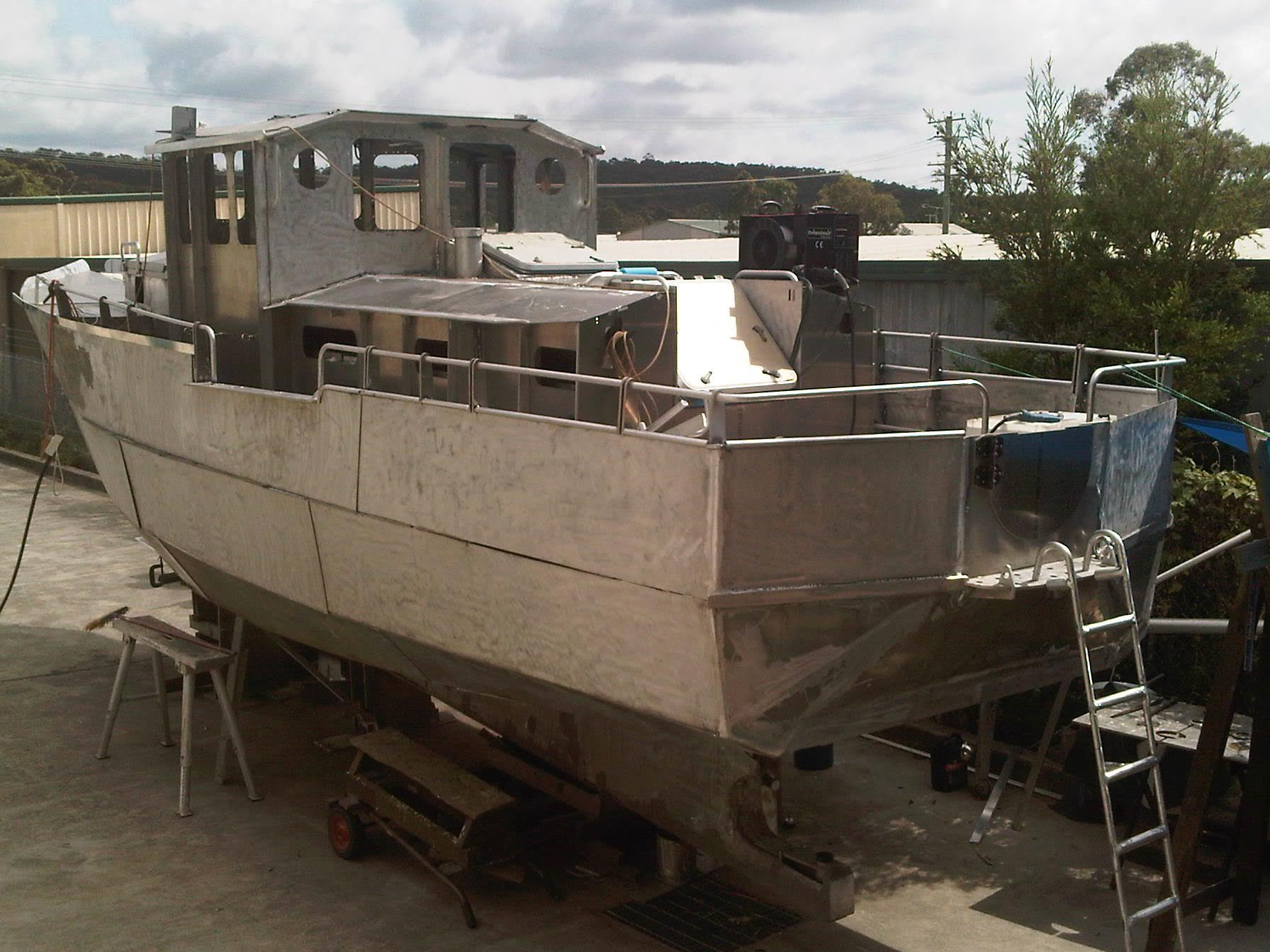 Arne boat build progressing in 2012 with Tokentools MIG Welder atop the vessel
